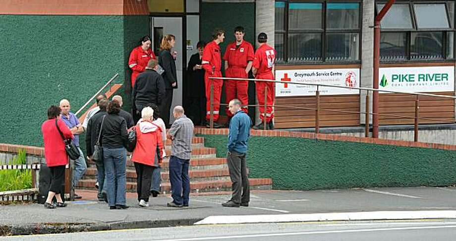 People arrive at the offices of Pike River Coal in Greymouth on November 20, 2010, where families of the 29 missing coal miners gather to learn more information on the fate of the trapped miners. Twenty-nine miners are missing after an explosion tore through an underground mine on New Zealand's remote west coast on November 19, with fears of another blast frustrating rescue efforts, police said.  Two miners survived but there had been no contact with any others, the mining company's chief executive said. Photo: William West, AFP/Getty Images