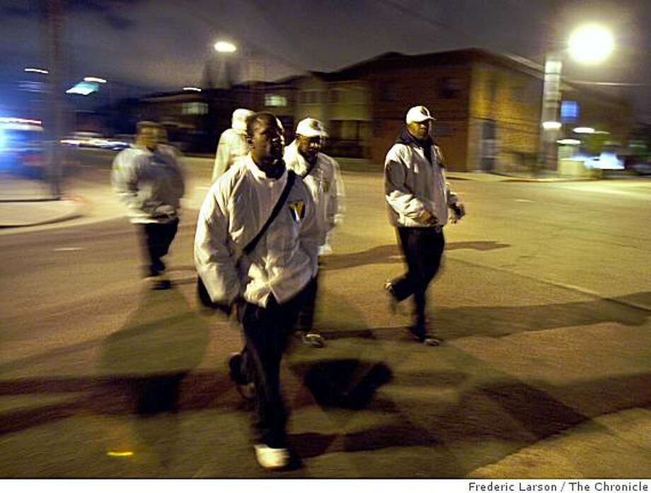 A small group of men from a outreach program patrol the high crime neighborhoods of Oakland to help any wayward youth and others in need in the wake of the slayings of four police officer on April 9, 2009. Photo: Frederic Larson, The Chronicle