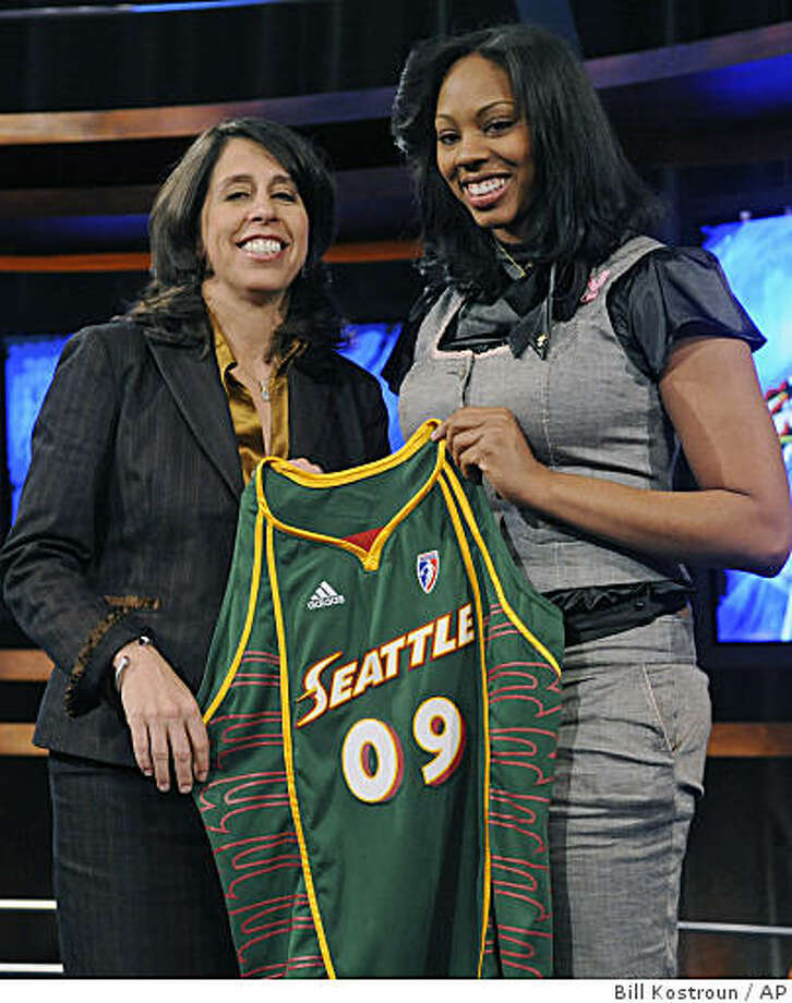 California's Ashley Walker, right, holds up a Seattle Storm jersey as she poses with WNBA president Donna Orender after Walker was chosen as the 12th overall pick in the WNBA basketball draft Thursday, April 9, 2009 in Secaucus, N.J. (AP Photo/Bill Kostroun) Photo: Bill Kostroun, AP