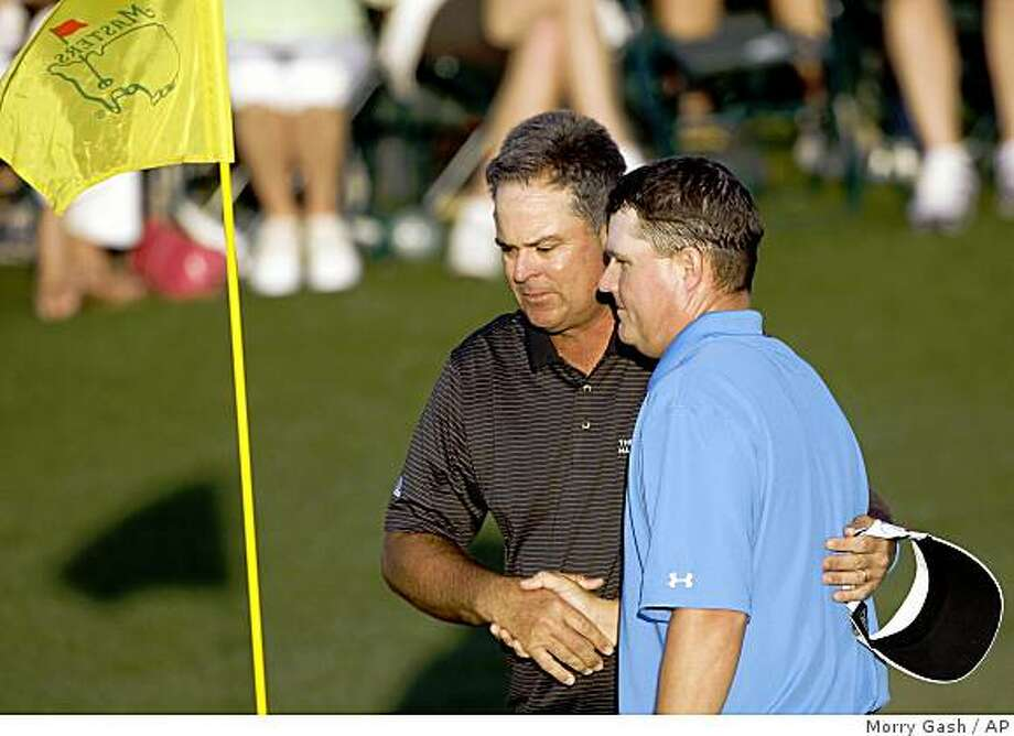 Kenny Perry, left, shakes hands with Chad Campbell on the 18th green following their the third round of the Masters golf tournament at the Augusta National Golf Club in Augusta, Ga., Saturday, April 11, 2009. (AP Photo/Morry Gash) Photo: Morry Gash, AP