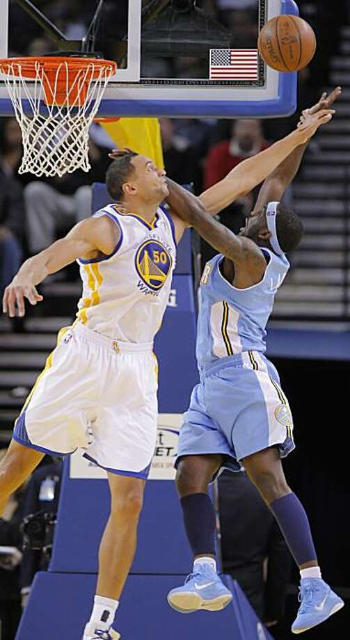 Dan Gadzuric fouls Ty Lawson as he goes up for a shot in the second half at Oracle Arena in Oakland on Monday. Photo: Carlos Avila Gonzalez, The Chronicle