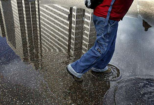 In San Francisco, all that was left of Saturday night's blustery weather were some large puddles and cool temperatures Sunday. Photo: Brant Ward, The Chronicle
