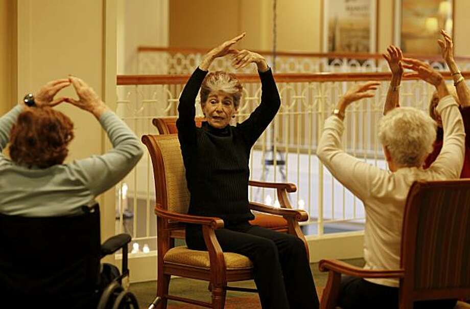 Margrit Paul (center) watches her students, some of whom are in wheelchairs. Margrit Paul teaches ballet movements to senior care facilities in the Bay Area including AlmaVia in San Rafael, Calif. Thursday November 18, 2010. Photo: Brant Ward, The Chronicle