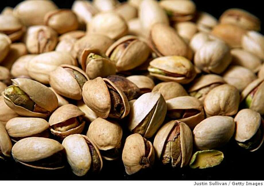 SAN FRANCISCO - MARCH 31:  Pistachios sit on a table March 31, 2009 in San Francisco, California. The U.S. Food and Drug Administration is asking consumers to avoid eating pistachios after a Central California pistachio processor issued a voluntary recall on pistachios due to potential salmonella contamination.  (Photo Illustration by Justin Sullivan/Getty Images) Photo: Justin Sullivan, Getty Images