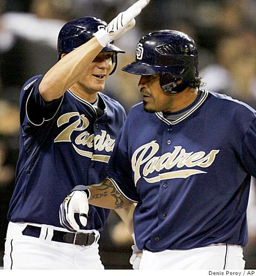 San Diego Padres' Henry Blanco, right, is congratulated by teammate Jake Peavy after Blanco hit a solo home run off of San Francisco Giants pitcher Jonathan Sanchez during the fifth inning of a baseball game Saturday, April, 11, 2009 in San Diego.  (AP Photo/Denis Poroy) Photo: Denis Poroy, AP