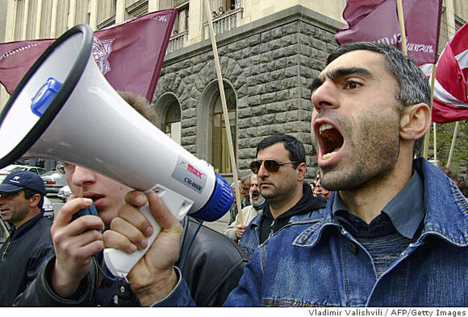 A Georgian man chants an anti-Saakashvili slogan at a rally in central Tbilisi on April 9, 2009. Opposition leaders have vowed to rally at least 100,000 supporters and to carry on their protests until the flamboyant but under-fire President Mikheil Saakashvili resigns and calls early elections.                     AFP PHOTO / VLADIMIR VALISHVILI (Photo credit should read VLADIMIR VALISHVILI/AFP/Getty Images) Photo: Vladimir Valishvili, AFP/Getty Images