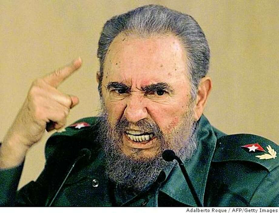 """(FILES) In this 04 September1999 file photo, Cuban President Fidel Castro discusses his request to the president of the International Olympic Committee in Havana for an investigation into the treatment of certain Cuban atheletes. Castro said the communist nation is not afraid of dialogue with the United States -- and not interested in continued confrontation with its powerful neighbor.  The comments came as a group of US lawmakers visited Cuba this weekend to try to end nearly half a century of mutual distrust and amid reports that President Barack Obama was planning to ease economic sanctions on the island, including travel restrictions on Cuban-Americans. """"We're not afraid to talk with the United States. We also don't need confrontation to exist, like some fools like to think,"""" Castro, 82, said in an article on the Cubadebate website on April 5, 2009.  AFP PHOTO/ADALBERTO ROQUE /FILES (Photo credit should read ADALBERTO ROQUE/AFP/Getty Images) Photo: Adalberto Roque, AFP/Getty Images"""