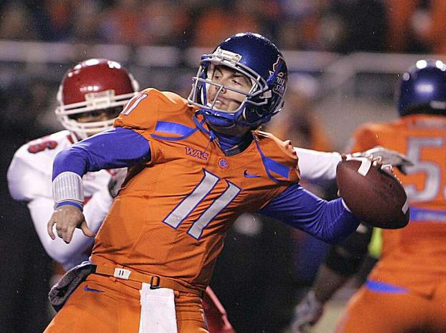 Boise State's Kellen Moore (11) throws against Fresno State during the first half of an NCAA college football game on Friday, Nov. 19, 2010 in Boise, Idaho. Photo: Matt Cilley, AP