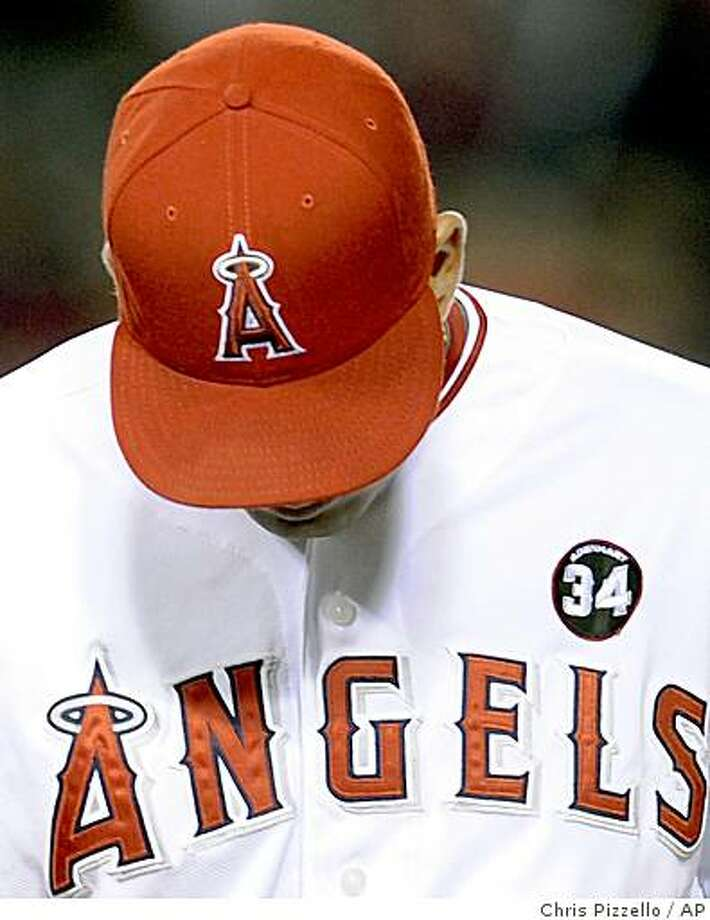 Los Angeles Angels first baseman Kendry Morales wears a number 34 patch in honor of rookie pitcher Nick Adenhart during the sixth inning of a baseball game against the Boston Red Sox in Anaheim, Calif., Friday, April 10, 2009. Adenhart and two other people were killed in an auto accident early Thursday in Fullerton, Calif. hours after Adenhart pitched in his season debut. (AP Photo/Chris Pizzello) Photo: Chris Pizzello, AP