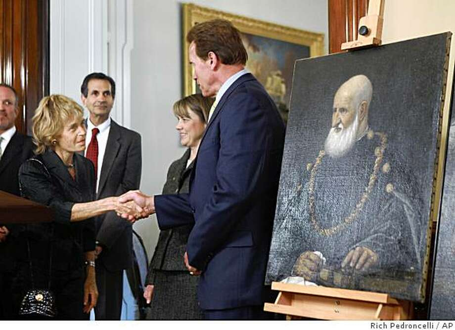 Inge Blackshear, of Buenos Aires, Argentina, left, thanks Gov. Arnold Schwarzenegger for the return of two Renaissance paintings to her family during ceremonies in Sacramento, Calif., Friday, April 10, 2009.  The paintings once belonged to Jakob and Rosa Oppenheimer, art dealers who in 1935 were forced to sell work in a liquidation auction of their Berlin gallery. At the time, Germany required Jewish citizens to report their assets to the government.  Seen in the center is Ruth Coleman, director of the California Department of Parks and Recreation.(AP Photo/Rich Pedroncelli) Photo: Rich Pedroncelli, AP