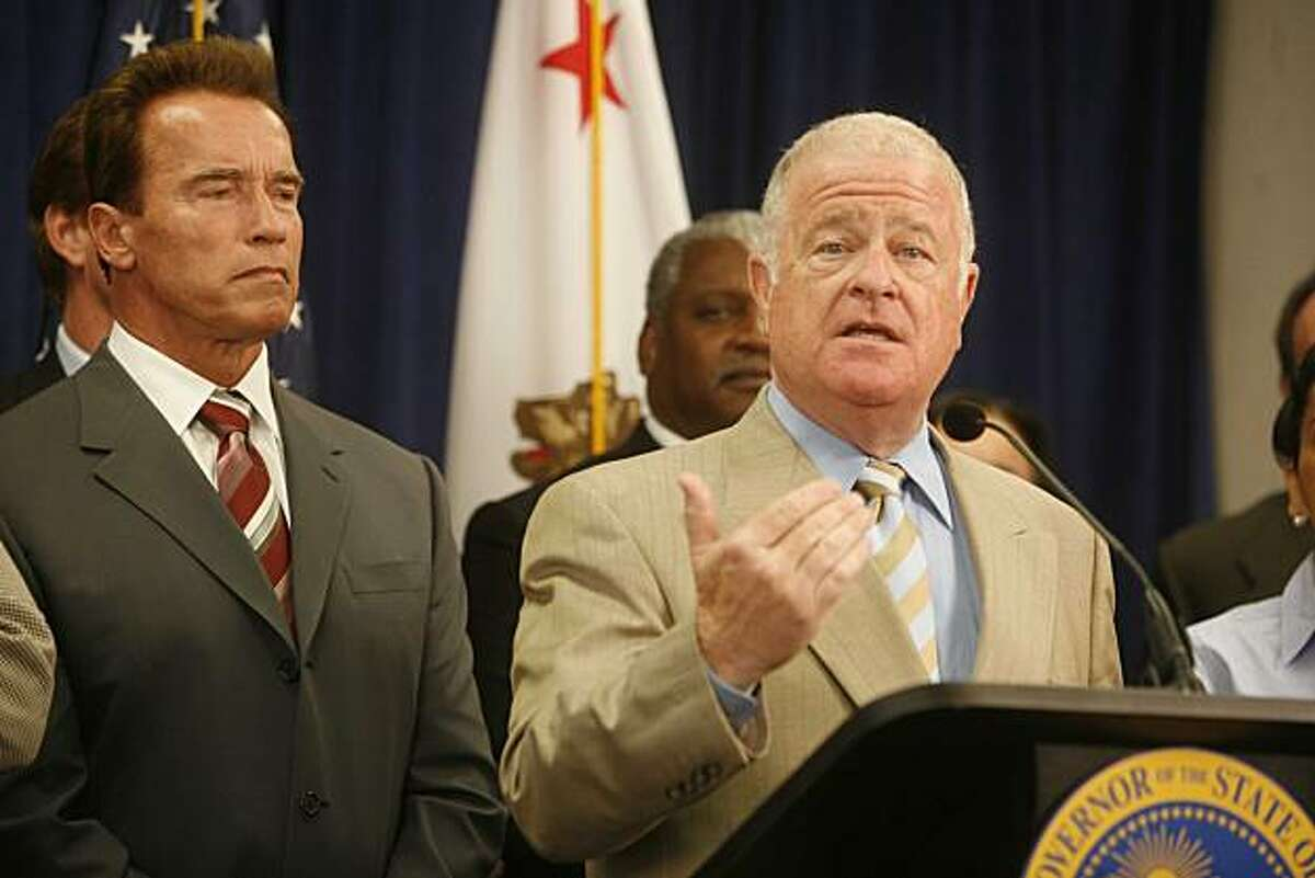 Before signing a foreclosure bill called SB1137, Governor Arnold Schwarzenegger listens to Senate President pro Tem, Don Perata speak during a press conference held at The Unity Council building on Tuesday July 8, 2008 in Oakland, Calif. Photo by Mike Kepka / The Chronicle