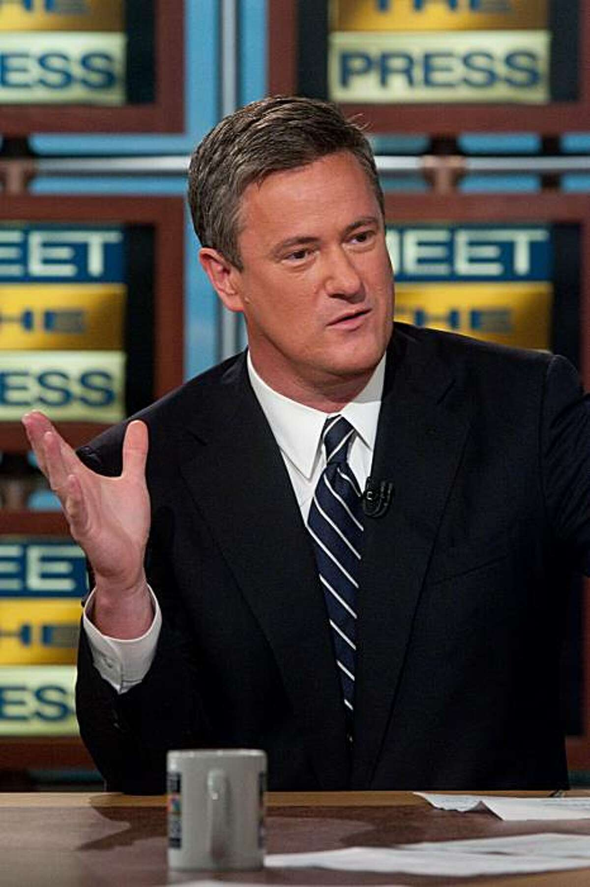 """FILE - In this April 3, 2009 file photo originally released by NBC, Joe Scarborough, host of MSNBC's """"Morning Joe"""" right discusses the future of the Republican party on NBC's """"Meet the Press"""" in Washington. MSNBC says it's suspending morning host Joe Scarborough for two days without pay for making political contributions.The eight donations, each for $500, violate NBC News policy, MSNBC president Phil Griffin said Friday, Nov. 19, 2010."""