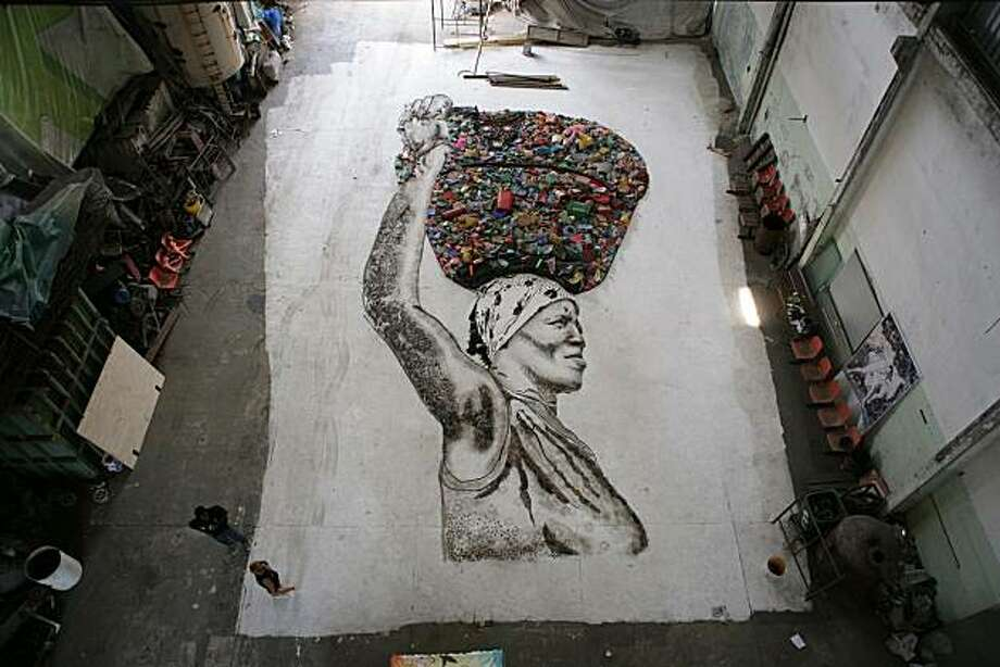 Filmed over nearly three years, WASTE LAND follows renowned artist Vik Muniz as he journeys to his native Brazil and the world's largest garbage dump, Jardim Gramacho, located on the outskirts of Rio de Janeiro. There he photographs an eclectic band of ÒcatadoresÓÑself-designated pickers of recyclable materials. MunizÕs collaboration with these inspiring characters as they recreate photographic images of themselves out of garbage reveals both the dignity and despair of the catadores as they begin to re-imagine their lives. Photo: Arthouse Films