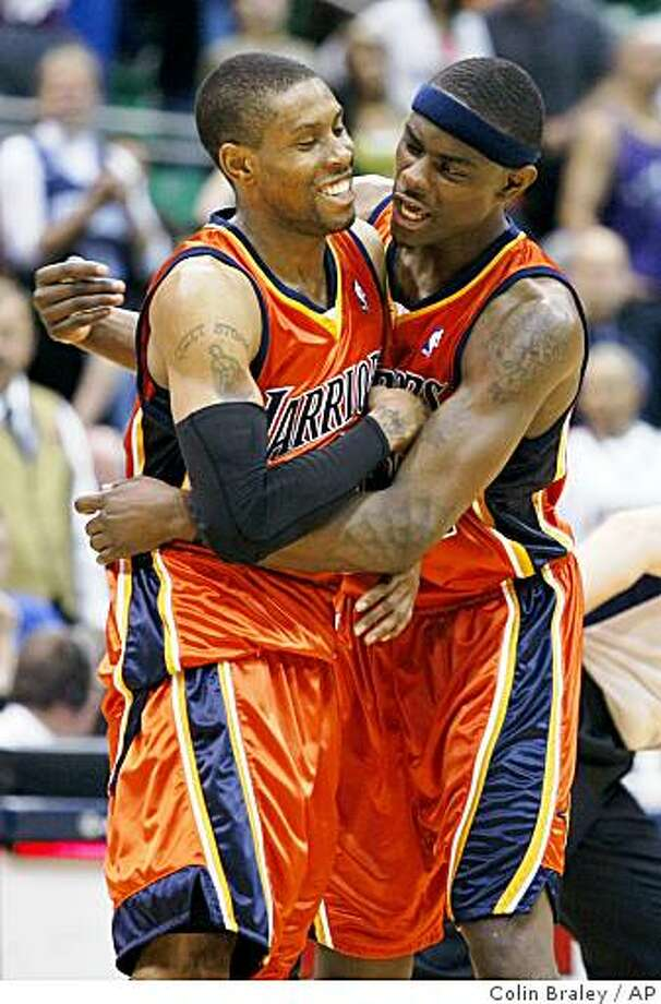 Golden State Warriors' C.J. Watson, left, and Anthony Morrow celebrate their 118-108 victory over the Utah Jazz in their NBA basketball game Saturday, April 11, 2009, in Salt lake City. Watson scored 38 points in their win. (AP Photo/Colin Braley) Photo: Colin Braley, AP