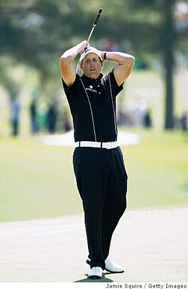 AUGUSTA, GA - APRIL 09:  Phil Mickelson reacts to a missed putt on the 18th hole during the first round of the 2009 Masters Tournament at Augusta National Golf Club on April 9, 2009 in Augusta, Georgia.  (Photo by Jamie Squire/Getty Images) Photo: Jamie Squire, Getty Images