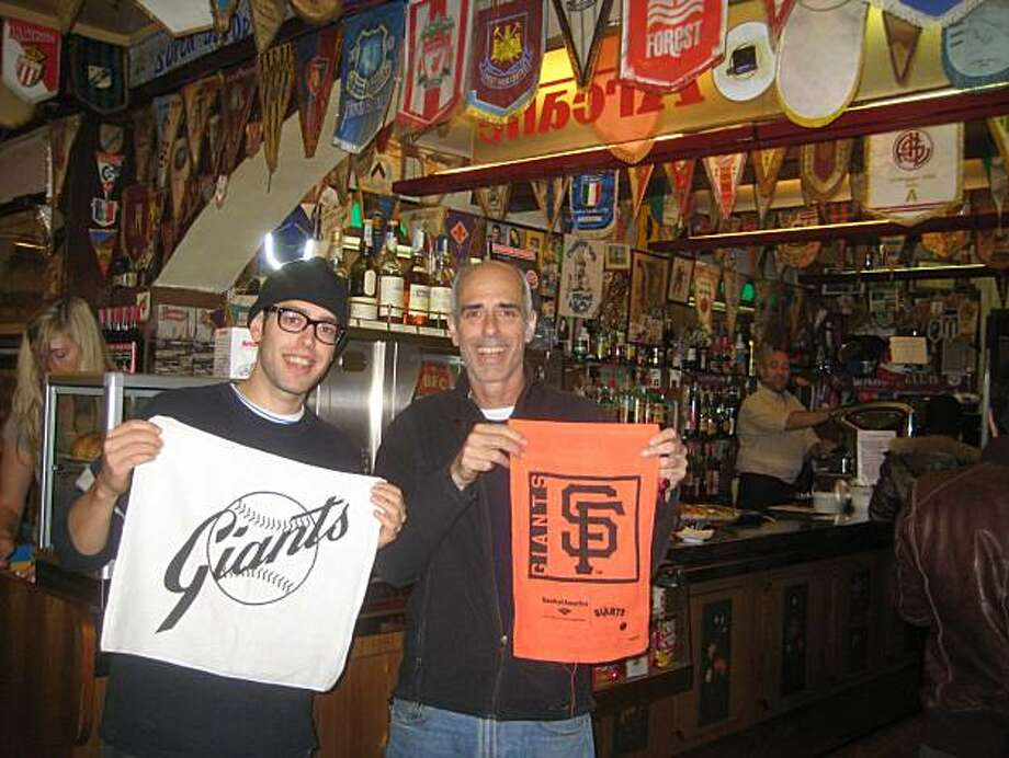 Matthew and Douglas Stewart of San Francisco celebrate the Giants World Series victory at Bar Civili in Livorno, Italy. Photo: *