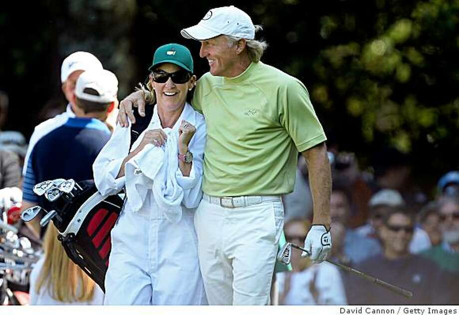 AUGUSTA, GA - APRIL 08:  Greg Norman of Australia celebrates his hole-in-one on the sixth hole with his wife/caddie Chris Evert during the Par 3 Contest prior to the 2009 Masters Tournament at Augusta National Golf Club on April 8, 2009 in Augusta, Georgia.  (Photo by David Cannon/Getty Images) Photo: David Cannon, Getty Images