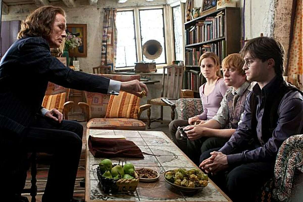 In this film publicity image released by Warner Bros. Pictures, from left, Bill Nighy, Emma Watson, Rupert Grint and Daniel Radcliffe are shown in a scene from