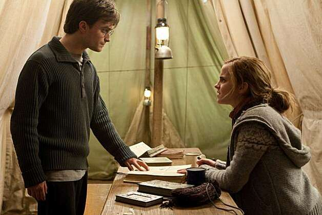 "In this film publicity image released by Warner Bros. Pictures, Daniel Radcliffe, left, and Emma Watson are shown in a scene from ""Harry Potter and the Deathly Hallows: Part 1."" Photo: Jaap Buitendijk, AP"