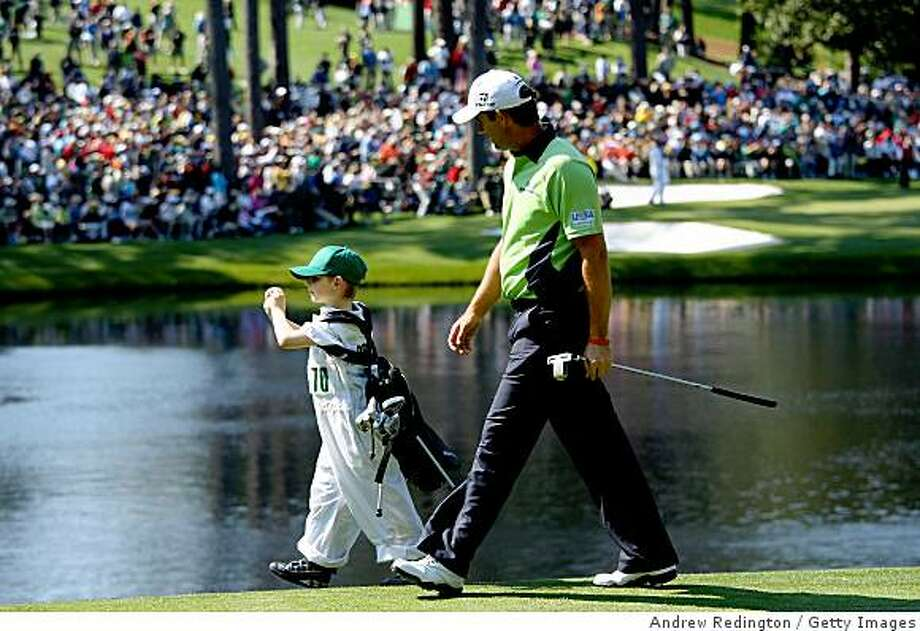 AUGUSTA, GA - APRIL 08:  Padraig Harrington of Ireland alongside his son Patrick during the Par 3 Contest prior to the 2009 Masters Tournament at Augusta National Golf Club on April 8, 2009 in Augusta, Georgia.  (Photo by Andrew Redington/Getty Images) Photo: Andrew Redington, Getty Images
