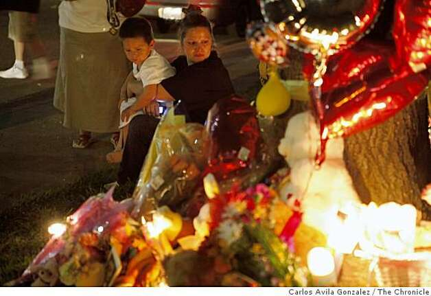 Brandy Robles, and her son, Daniel Chavera, 2, sit by the memorial for Sandra Cantu after Tracy authorities held a press conference revealing that the contents of a sealed container were indeed the remains of Sandra Cantu on Monday, April 6, 2009. Cantu has been missing since March 27, 2009. Photo: Carlos Avila Gonzalez, The Chronicle