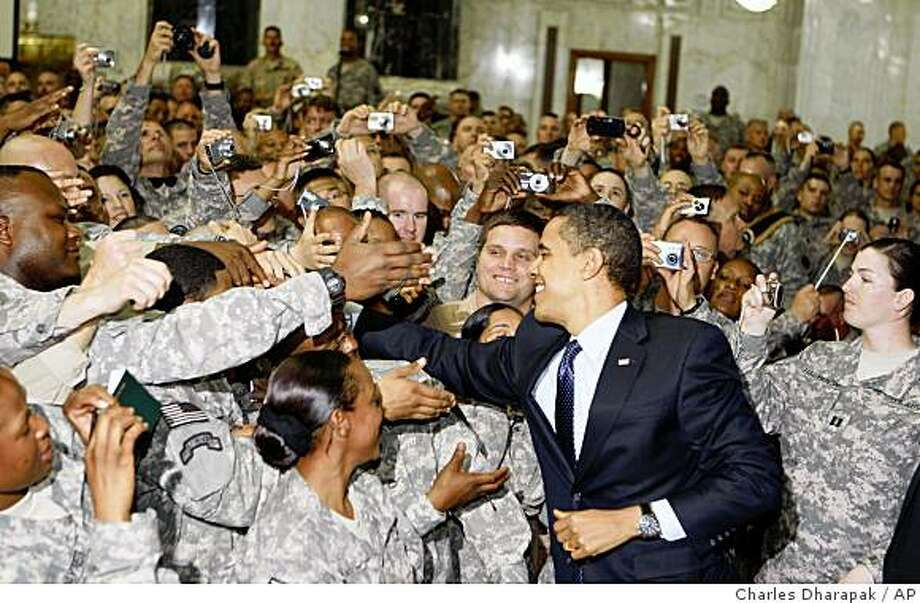 President Barack Obama greets military personnel at Camp Victory in Baghdad, Iraq, Tuesday, April 7, 2009. (AP Photo/Charles Dharapak) Photo: Charles Dharapak, AP