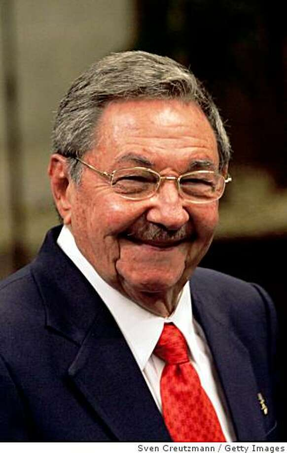 HAVANA, CUBA - FEBRUARY 16:  (NO SALES/NO MAGAZINES FOR EDITORIAL USE ONLY) Cuba's current President Raul Castro smiles after he receives on behalf of Cuba's Revolution leader Fidel Castro, the Quetzal medal, Guatemala's highest distinction, from the President of Guatemala Alvaro Colom Caballeros in the State Council on February 16, 2009 in Havana, Cuba. The President of Guatemala is on a four day visit to Cuba to strengthen relations between the two countries.  (Photo by Sven Creutzmann/Mambo photo/Getty Images) Photo: Sven Creutzmann, Getty Images