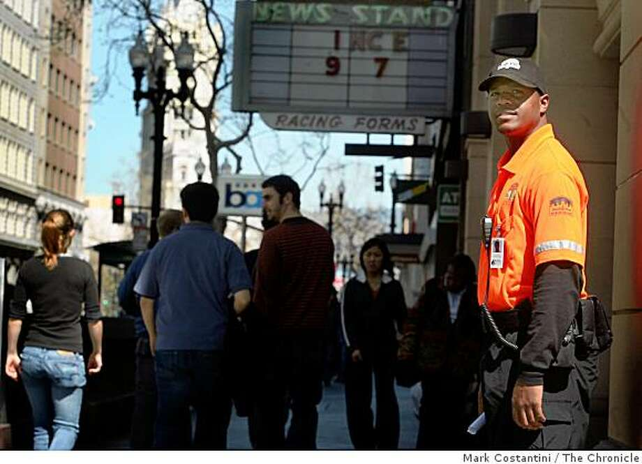 Downtown Oakland Association Security Ambassador Kirk Humbles patrols Broadway near 14th Street in Oakland, Calif. on Thursday,  March 19, 2009 Photo: Mark Costantini, The Chronicle