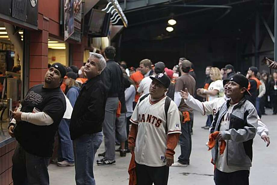 Daniel Trejo (l to r), Brad Crutchfield, Jim Caal, Juanito Serrano and Abraham Serrano (partially hidden behind Juanito Serrano) react while watching Game 4 of the National League Championship Series from a concession stand line at AT&T Park on Wednesday, October 20, 2010 in San Francisco, Calif. Photo: Lea Suzuki, The Chronicle