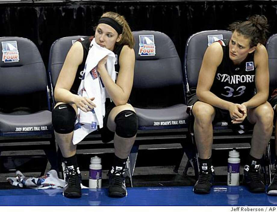 Stanford's Kayla Pedersen, left, and Jillian Harmon watch from the bench late in the second half against Connecticut in a semifinal of the NCAA women's college basketball tournament Final Four on Sunday, April 5, 2009, in St. Louis. Connecticut beat Stanford 83-64 to advance to Tuesday's championship game against Louisville. (AP Photo/Jeff Roberson) Photo: Jeff Roberson, AP