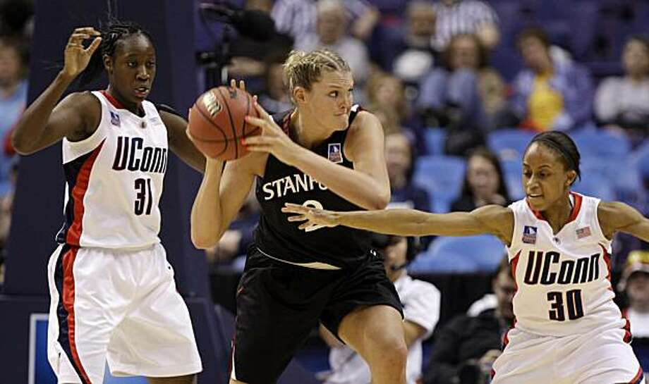 Stanford's Jayne Appel, center, looks to escape from Connecticut's Tina Charles, left, and Lorin Dixon during the second half in a semifinal of the NCAA women's college basketball tournament Final Four on Sunday, April 5, 2009, in St. Louis. (AP Photo/Lynne Sladky) Photo: Lynne Sladky, AP
