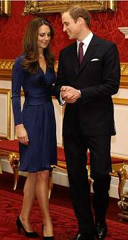 Aug. 8: Has any dress been knocked off more than the blue Issa London dress Kate Middleton wore for her engagement announcement? After countless imitations hit the market, Issa gets back in on the action. The British designer teams up with Banana Republic on a collection that includes, you guessed it, a very similar-looking dress. Photo: Sang Tan, AP