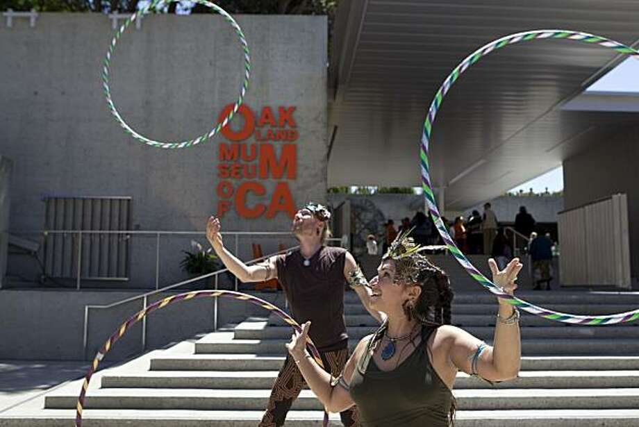 Andrew Kaus and Kandice Kaus from Holistic Hooping perform their  routine during the Oakland Museum of California reopening ceremonies in Oakland, Calif., on Saturday, May 01, 2010. Photo: Laura Morton, Special To The Chronicle