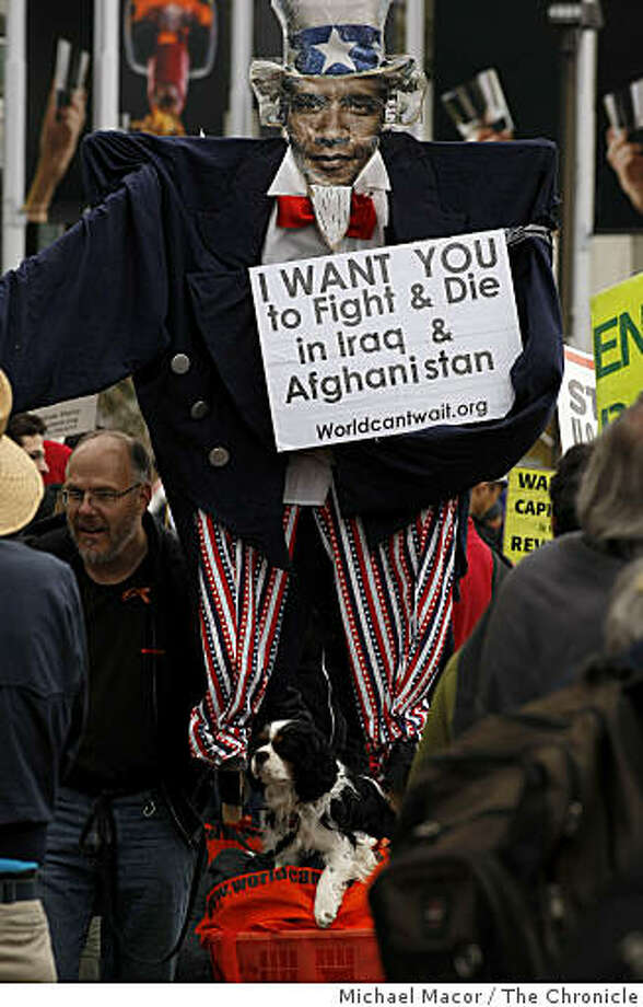 Marchers head up Market Street while hundreds gather in San Francisco, Calif. on Saturday March 21, 2009,  for the, on what organizers called the, International Day of Action March on the 6th Anniversary of the  Invasion of Iraq. Photo: Michael Macor, The Chronicle
