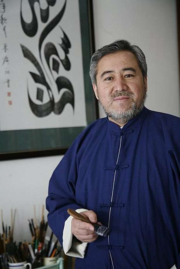 Haji Noor Deen Mi Guang Jiang has developed his own  calligraphic style based on Chinese and Islamic traditions. Photo: Ho