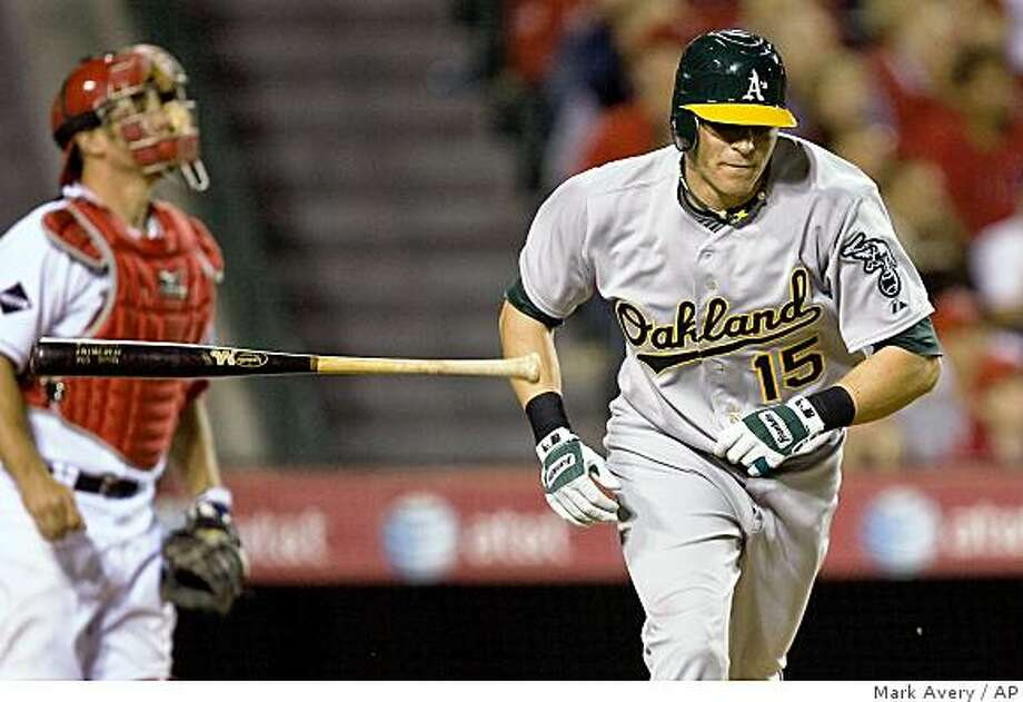 Oakland Athletics' Ryan Dweeney throws the bat after hitting a pop fly for an out against the Los Angeles Angels in the eighth inning of a baseball game in Anaheim, Calif., Monday, April 6, 2009. (AP Photo/Mark Avery) Photo: Mark Avery, AP