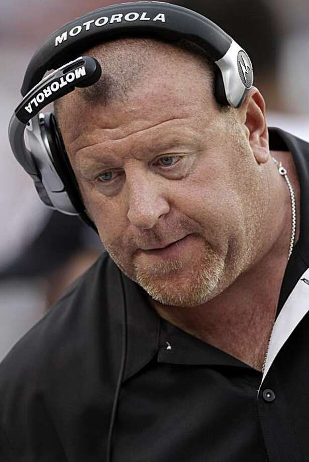 Oakland Raiders head coach Tom Cable follows the action his team against the Denver Broncos during the second half of their NFL football game, Sunday, Oct. 24, 2010, in Denver. The Raiders won 59-14. Photo: Joe Mahoney, AP