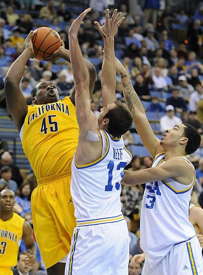 California center Markhuri Sanders-Frison shoots over UCLA forward James Keefe and forward Tyler Honeycutt during the first half Saturday in Los Angeles. Photo: Gus Ruelas, AP