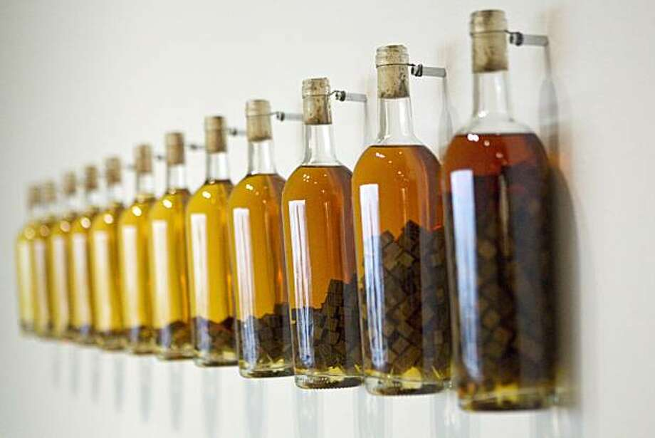 "An installation of bottles showing how the addition of oak chips changes wine is seen at the ""How Wine Became Modern"" exhibit at the San Francisco Museum of Modern Art in San Francisco, Calif., on Monday, November 15, 2010. Photo: Laura Morton, Special To The Chronicle"