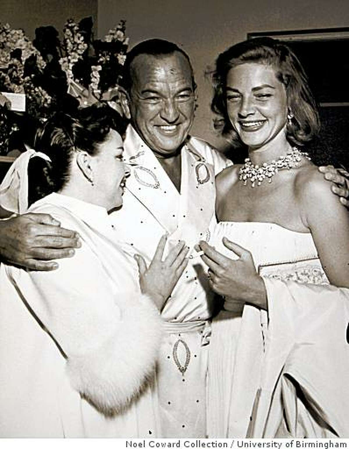 After experiencing a serious career slump following the Second World War, Coward came back with a vengeance in a smash hit nightclub act of his own songs. His star-turn in Las Vegas lead to a complete resurgence of Coward?s career. He?s shown here backstage at Wilbur Clark?s Desert Inn in Las Vegas with Judy Garland and Lauren Bacall, 1955. The dressing gown pictured here is on display in the exhibition.