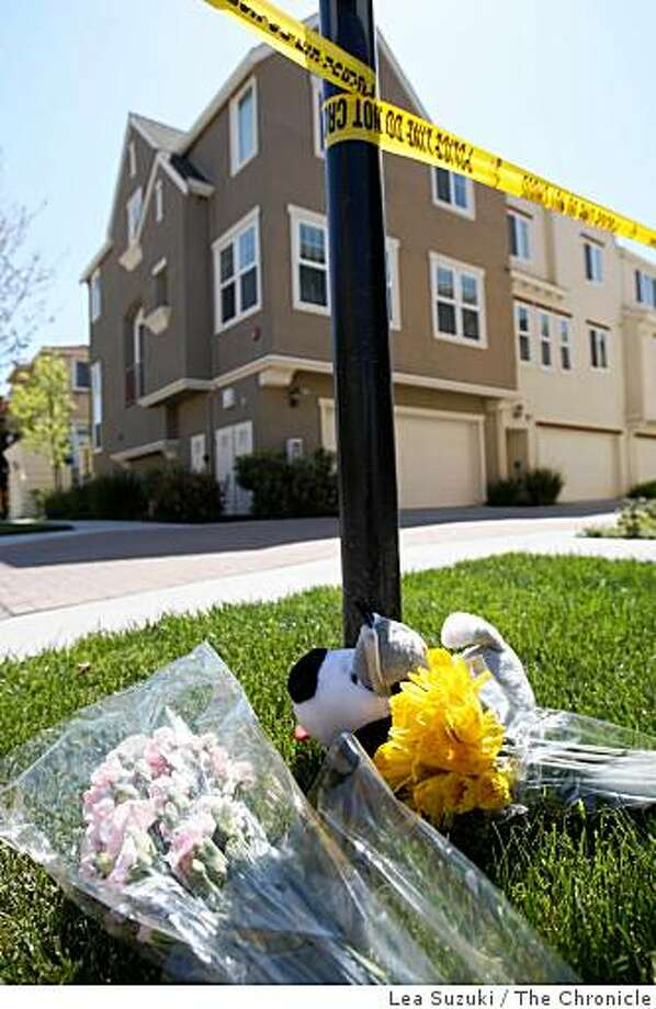 Flowers were placed on the grass on Headen Way and Kelley Way behind which stand a row of townhouses in Santa Clara, Calif. on Monday March 30, 2009. Photo: Lea Suzuki, The Chronicle