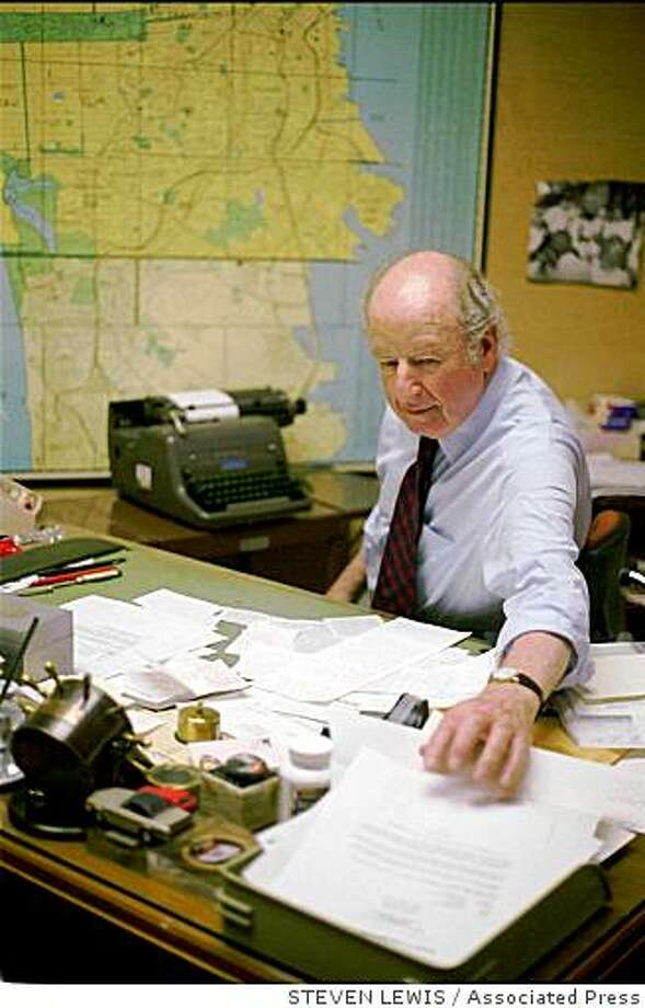 : San Francisco Chronicle columnist Herb Caen reaches for a letter on top of his desk while typing his daily column Tuesday Nov. 15, 1994, in the Chronicle's downtown San Francisco newsroom. The 56-year veteran of the newspaper returned to work today following a 12-day strike which was settled over the weekend. (AP Photo/Steven Lewis) San Francisco Chronicle columnist Herb Caen reaches for a letter on top of his desk while typing his daily column Tuesday Nov. 15, 1994, in the Chronicle's downtown San Francisco newsroom. The 56-year veteran of the newspaper returned to work today following a 12-day strike which was settled over the weekend. (AP Photo/Steven Lewis) Photo: STEVEN LEWIS, Associated Press