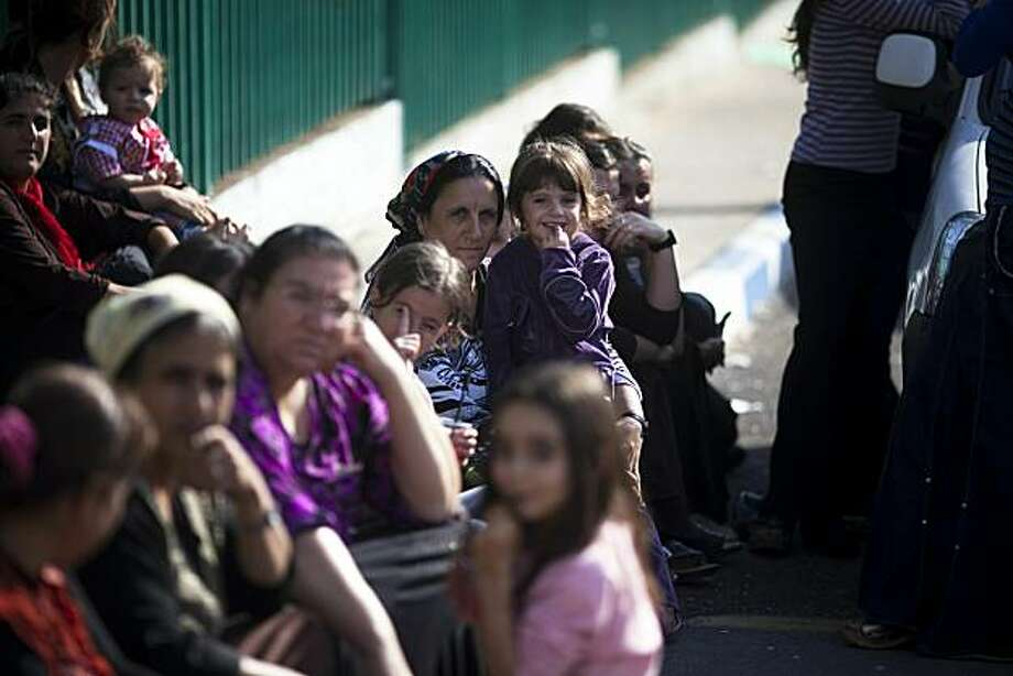 GHAJAR, ISRAELI-LEBANESE BORDER - NOVEMBER 17: Local women and their children sit November 17, 2010 in the village of Ghajar, on Israeli-Lebanese border. Israel's cabinet approved today a plan to withdraw from the northern half of the village of Ghajar, which was recaptured during the 2006 war against Hezbollah guerrillas in Lebanon. Photo: Uriel Sinai, Getty Images