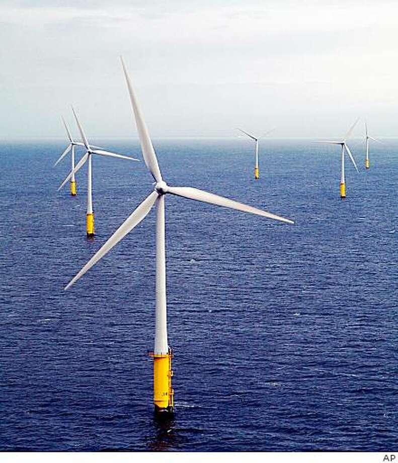 ** FILE ** In this 2004 file photo supplied by Vestas Wind Systems, offshore wind turbines at North Hoyle in Wales, western Britain, are shown. Windmills off the East Coast could generate enough electricity to replace most, if not all, the coal-fired power plants in the United States, Interior Secretary Ken Salazar said Monday, April 6, 2009. (AP Photo/Vestas Wind Systems, file) ** EDITORIAL USE ONLY, NO SALES** Photo: AP