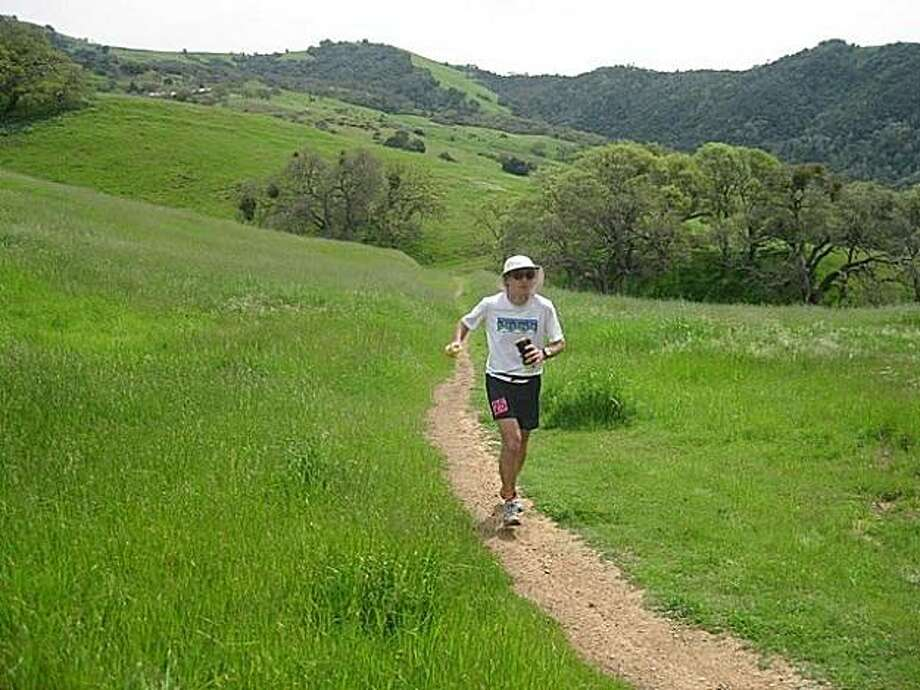 """Dr. Harris Goodman runs a 100-mile race in Vermont en route to the """"Grand Slam of Ultrarunning."""" Photo: Courtesy Dr. Harris Goodman"""