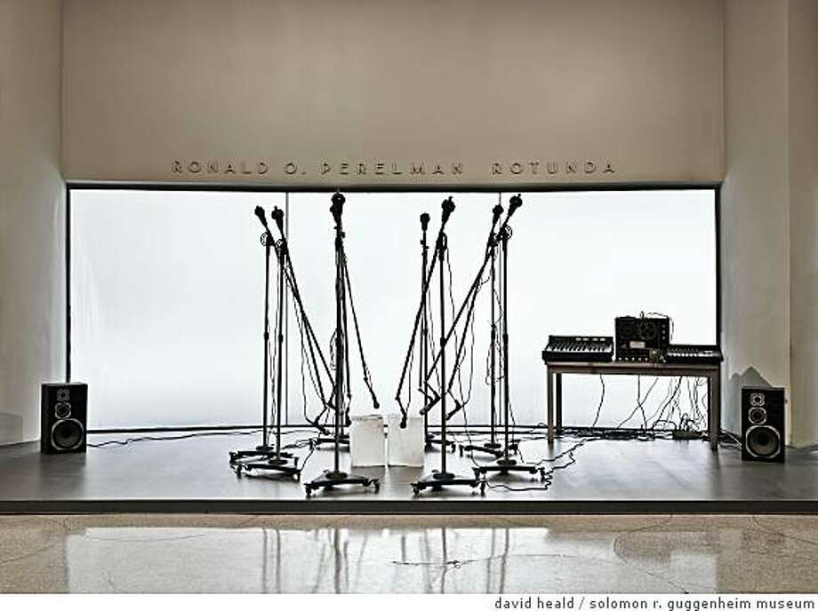 """Sound of Ice Melting"" (1970)Two 25-pound blocks of ice, eight boom microphone stands, eight microphones, mixer, amplifier, two speakers, and cables by Paul KosDimensions variableCollection of the artist Photo: David Heald, Solomon R. Guggenheim Museum"