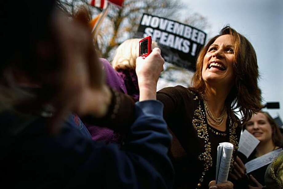 """WASHINGTON - NOVEMBER 15:  Rep. Michele Bachmann (R-MN) (2nd R) greets supporters during a rally organized by Americans for Progress on Capitol Hill November 15, 2010 in Washington, DC. Associated with the Tea Party movement, Americans for Progress members and supporters rallied to """"send a clear message to Washington that voters have spoken this November and that politicians should not pursue big government policies in the Lame Duck session."""" Photo: Chip Somodevilla, Getty Images"""