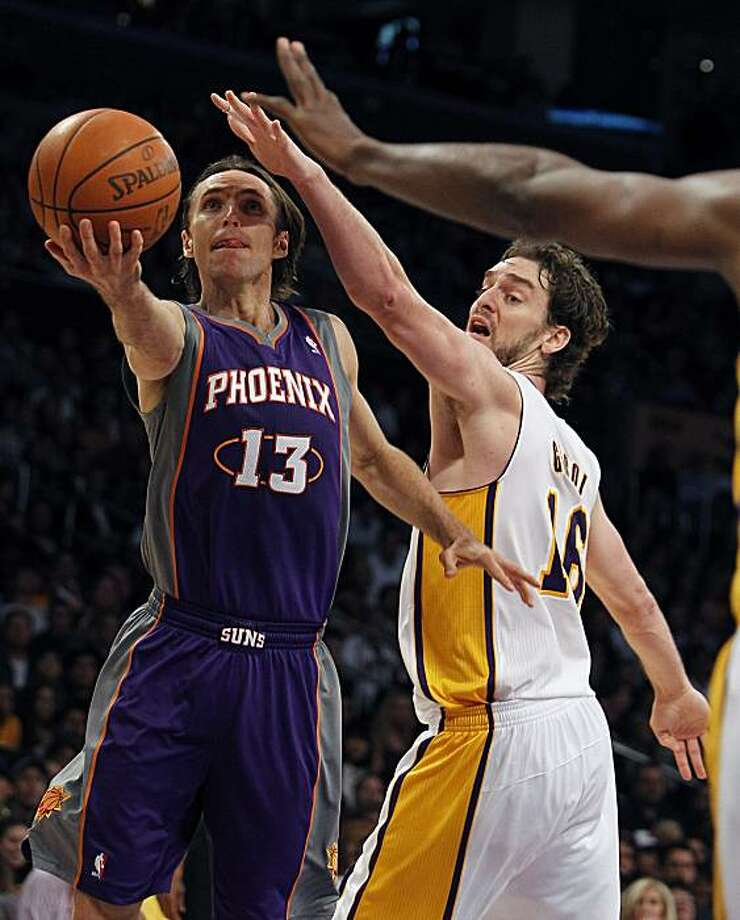 Phoenix Suns point guard Steve Nash (13) drives to the basket against Los Angeles Lakers power forward Pau Gasol (16), of Spain in the second half of an NBA basketball game in Los Angeles, on Sunday, Nov. 14, 2010. Suns won the game 121-116. Photo: Alex Gallardo, AP