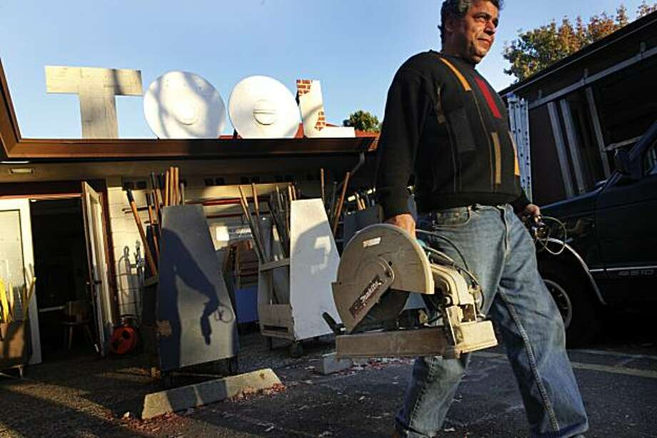 Hamid Bakhgiari, long time customer of the Berkeley Tool Lending library, walks out with a newly barrowed chop saw on Friday Nov. 12, 2010 in San Francisco, Calif. Photo: Mike Kepka, The Chronicle