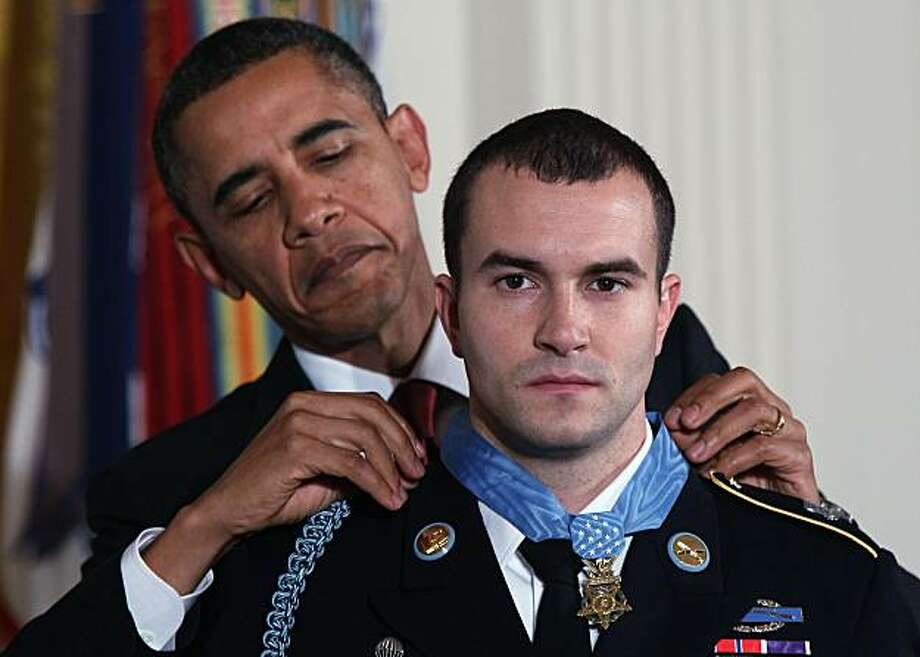 WASHINGTON - NOVEMBER 16: U.S. President Barack Obama awards Staff Sergeant Salvatore Giunta, U.S. Army, the Medal of Honor for conspicuous gallantry in the East Room of the White House November 16, 2010, in Washington, DC.  Staff Sergeant Giunta, of Cedar Rapids, Iowa, received the Medal of Honor for his courageous actions during combat operations in the Korengal Valley, Afghanistan in October 2007. Giunta is the first living recipient of the Medal of Honor since the Vietnam War. (Photo by Win McNamee/Getty Images) *** BESTPIX *** Photo: Win McNamee, Getty Images